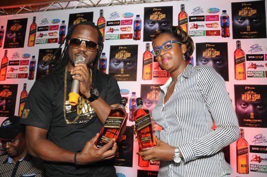 Bebe Cool and Lois Aber, Brand Manager- Premium Spirits at Uganda Breweries Ltd (UBL) unveil Johnnie Walker Black Label as a sponsor of the 2016 'Life of Bebe Cool' concert