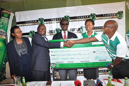 Johnson Omolo the President of the Uganda Golf Union receives  dummy cheque from the UBL Managing Director Mr. Nyimpini Mabunda
