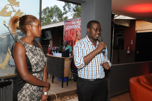 Edgar Birungi, UBL's Marketing Manager, Spirits addressing the media participants at the whisky mentoring session. Looking on is Lois Aber, UBL Brand Manager, Premium Spirits