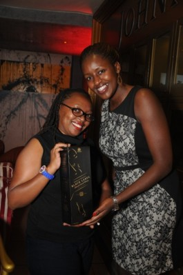 Lois Aber, UBL Brand Manager, Premium Spirits hands over one liter of Black Label to the Social Media Competition Winner, Phyllis Wanjiru