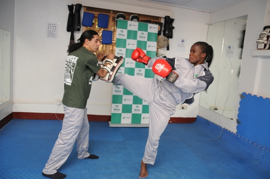 Patricia Apolot the current Female Lightweight World Kickboxing Champion going through her training drills