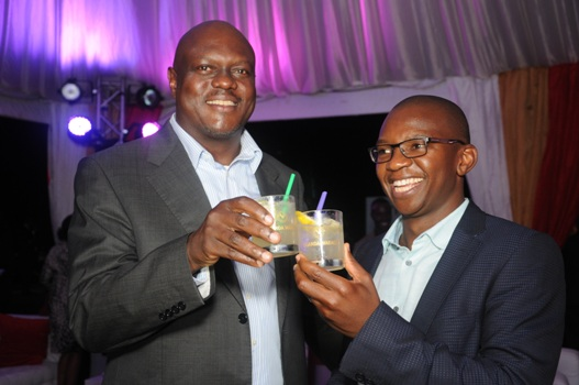 UBL In-coming Managing Director Mark Ocitti and Out- going MD Nyimpini Mabunda make a toast during the  cocktail dinner
