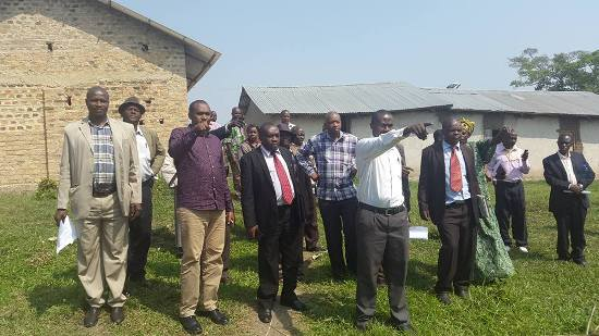 Frank Tumwebaze, Kule and stakeholders during assessement of schools