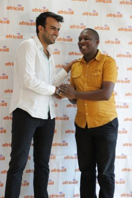 Africell Commercial Director Milad Khairallah (in white shirt) congratulates one of the first recipients of the triple MBs campaign