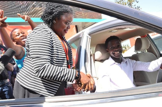 Airtel's Head of Brand and Communications with Steven Byamukama the 5th recharge and mujje tulumbe car winner