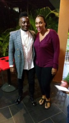 Jackie (R) with one of the Sauti Sol members