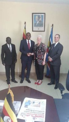 Frank Tumwebaze shakes hands with Deborah after a fruitful discussion