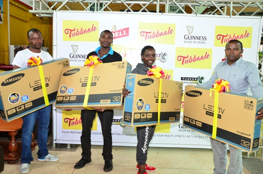 (R-L) Tibenduhusa Innocent, Nambuya Fatuma, Murungi Rogers, Wairugala Keith are some of the UBL's Tubbaale promotion flat screen winners in yet another prize redemption activity at Lambertini- UMA Showground