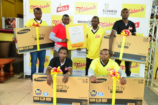 Winners of flat screen TVs and plots of land show off their prizes. A total of 38 televisions and 12 plots of land have so far been given away