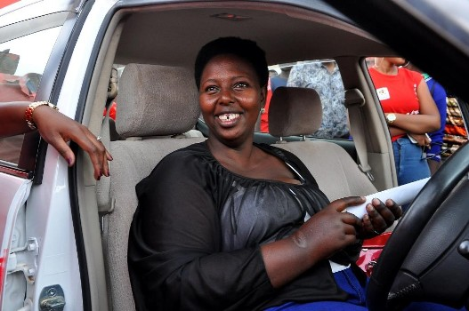 Mbarara's Grace Twongyeirwe the 2nd winner of Airtel MujjeTulumbe consumer promotion in her brand new car