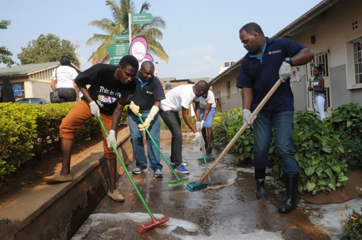 RwandAir team embracing the cleaning activity in Kisenyi Health Centre IV