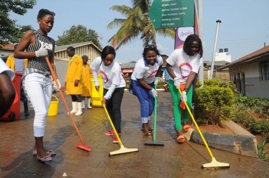 Spark Tv's staff participating in the Umuganda cleaning activity in Kisenyi