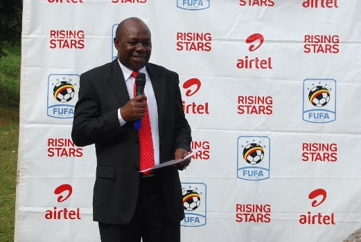 State Minister for Sports, Hon Charles Bakkabulindi, giving a speech during the Press launch of Airtel Raising Stars 6th season at Kibuli S.S