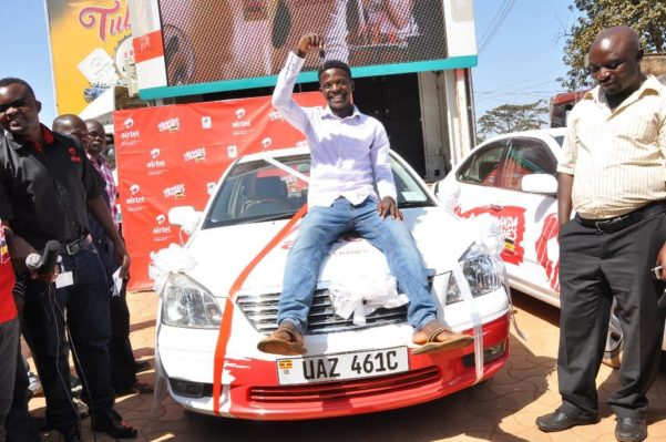 Steven Byamukama the senior six vacationist who recharged his airtime and won a brand new Toyota premio courtesy of Airtel's Mujje Tulumbe promotion