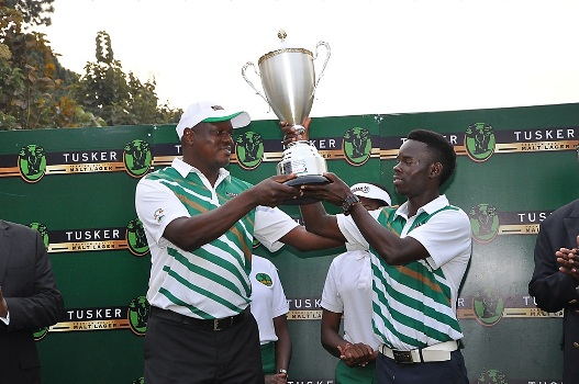 Uganda Breweries Managing Director presents the Tusker Malt Uganda Open trophy to Ronald Otile