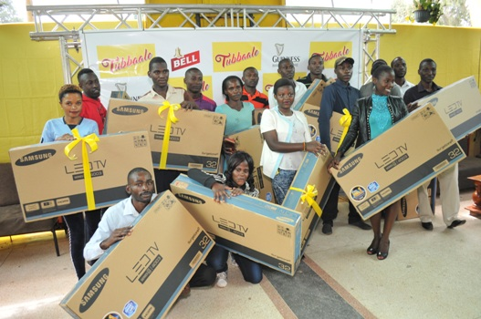 Winners of flat screen TVs with their prizes. A total of 26 TVs have so far been given away