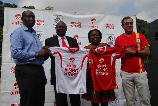 The State Minister for Sports Hon Charles Bakkabulindi, Airtel Uganda Head of Brand and communications, Remmie Kisakye, Airtel Uganda Chief Commercial Officer, Deepak Bhatia, and FUFA official unveiling the Airtel Rising Stars kit