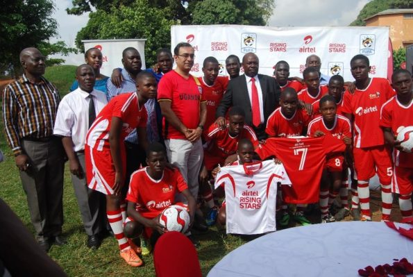 The State Minister for Sports, Charles Bakabulindi, Airtel Uganda Chief Commercial Officer, Deepak Bhatia, Airtel Uganda Officials, FUFA Officials pose for a group with the Airtel Rising Stars players during the Press launch