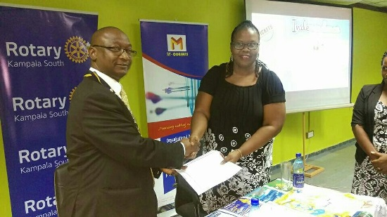 Christine Mawadri (R) after signing the partnership with Kampala South Rotary