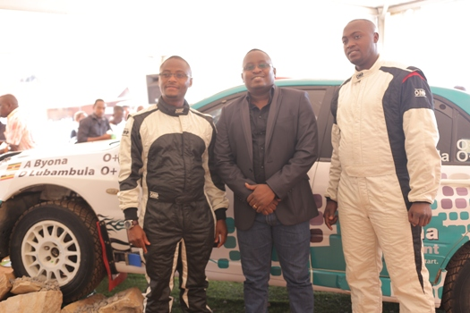 (L-R) Ambrose Byona, Allan Ssemakula, the Hima Cement Marketing Director and Derick Lubambula pose for a group photo during the Pearl Rally Press briefing