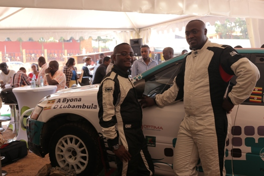 Ambrose Byona and Derrick Lubambula, the navigator pose next to their Hima Cement sponsored Mitsubishi Evo 9 during the Pearl Rally Press Conference