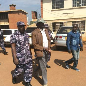 Buryo leaves Katwe Police Station for trial at Makindye Court