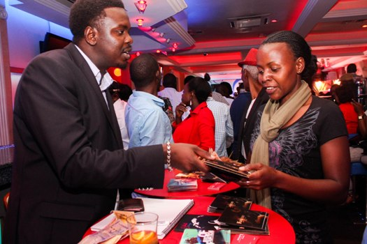 Guests purchase Njoroge's music CDs during the Johnnie Walker Jazz Night at Guvnor