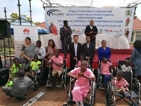 Mr Ni Long Huawei sales director middle with other officials and the donated wheelchairs