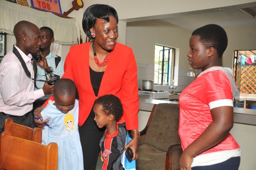 Olive Birungi Lumonya, SOS Uganda's National Director poses with SOS children from one of the Entebbe SOS Homes. The children are under Mama Harriet's care