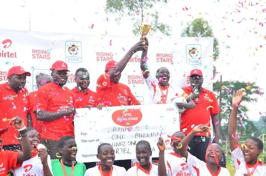rhines-s-s-team-captain-receives-the-trophy-and-dummy-cheque-of-ugx1000000-for-being-the-best-girls-team-in-the-ars-2016-buganda-regionals-copy