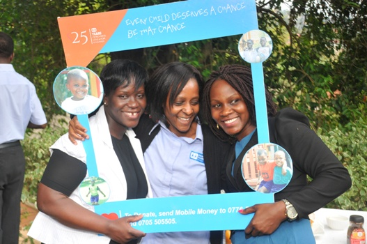 SOS Uganda staff try out the selfie frame during the Fundraising Campaign Launch in Entebbe