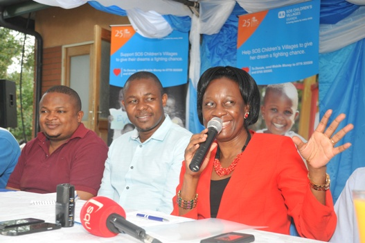 (L-R) Muhereza Kyamutetera, Managing Director at Corporate Image Ltd, SOS Children's Villages Lesotho National Director, Robert Tseuoa and Olive Birungi Lumonya SOS Uganda National Director giving her remarks during the launch of the Fundraising Drive