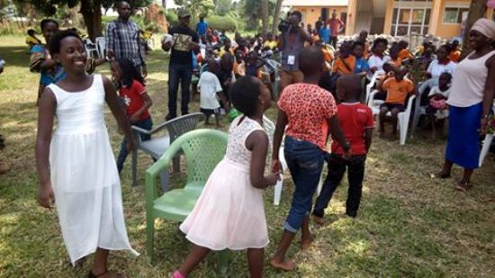 The children of Mr Rugyendo and Karuhanga playing the chair dance game with some of UWESO friends