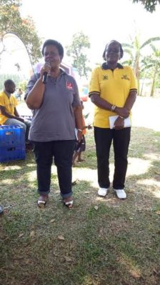 UWESO ED Ms Mabel Kiggundu giving a welcoming speech while UWESO's CEO Jenifer Aguti look on