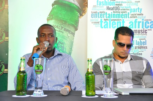 L-R Tusker Malt Brand Manager Alex Tusingwire speaking during the launch of the Kool & The Gang press conference alongside Talent Africa Group CEO, Aly Allibhai