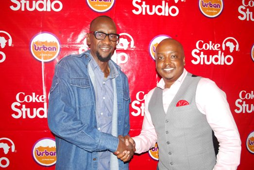 Coca-Cola Brand Manager, Rodney Nzioka pose for a photo with Vision Group's Michael Owor during the launch of Coke Studio Season 4