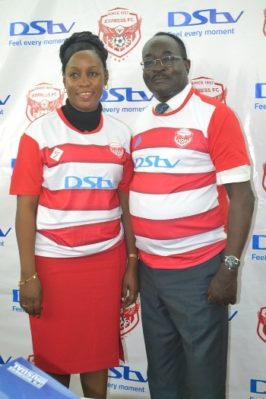 Hon Florence Kiyingi, Chairperson Express FC poses with MultiChoice Chairman Steven Musoke at the DStv sponsorship unveiling of Express FC