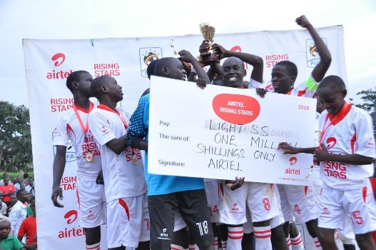 light-s-s-boys-team-celebrate-with-their-dummy-cheque-of-ugx-one-million-and-a-trophy-after-winning-the-ars-north-east-regionals-finals