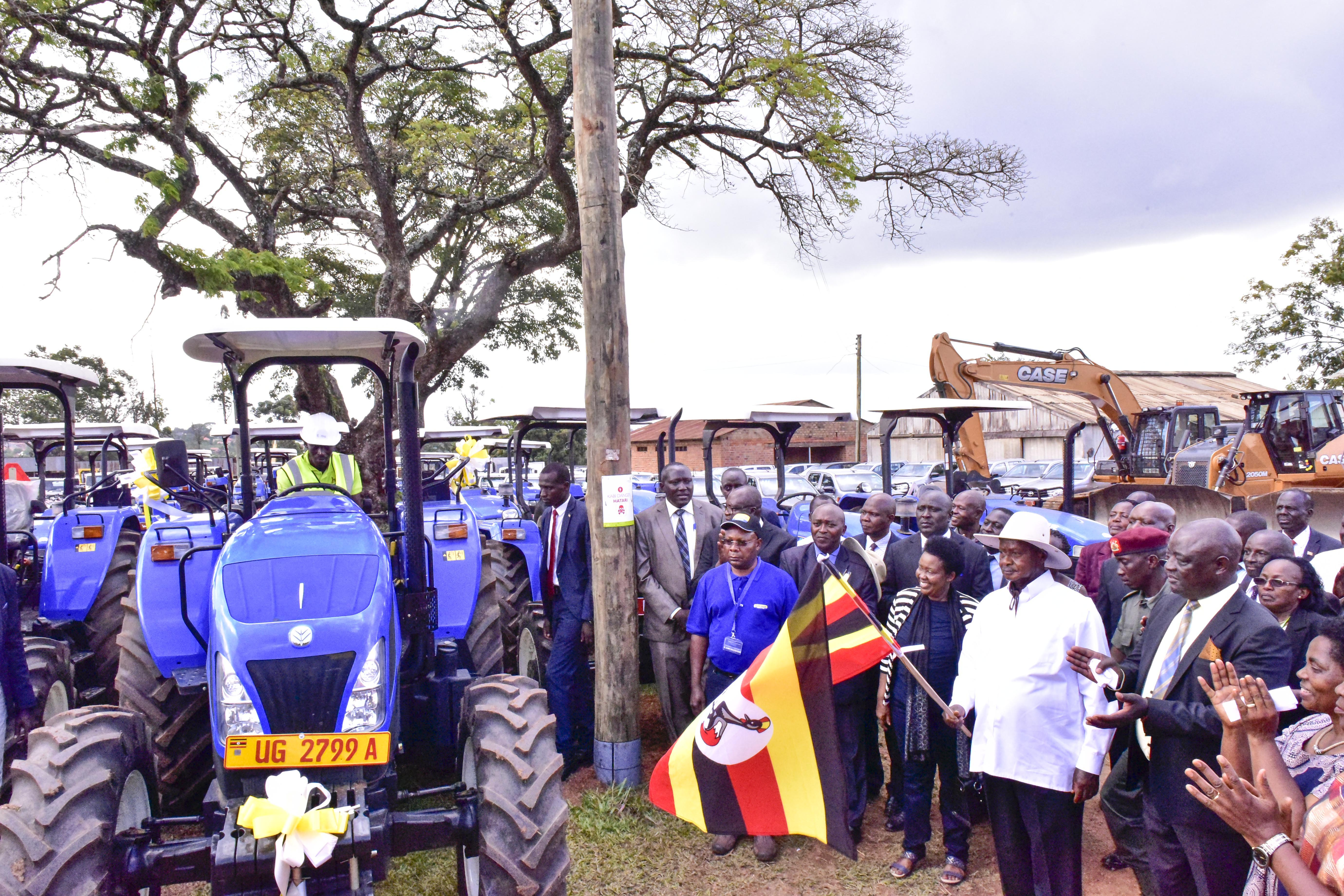 President Yoweri Kaguta Museveni flags off tractors and vehicles during the Launch and hand out heavy machinery tractors, motor vehicles and motor cycles to Agriculture extension workers for agric transformation in Namalere , Wakiso district on Thursday 7th March 2019